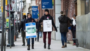 Teachers and faculty staff of the Ontario Public Service Employees Union walk the picket line at George Brown College in Toronto on Thursday, November 16, 2017. The Ontario government will try again today to introduce back-to-work legislation to end a nearly five-week strike by college faculty. THE CANADIAN PRESS/Nathan Denette