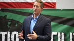 U.S. Sen. Jeff Flake speaks to aerospace workers about the current congressional tax reform proposal in Mesa, Ariz., Friday, Nov. 17, 2017. (AP Photo/Bob Christie)