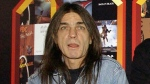 FILE - A March 3, 2003 file photo of AC/DC co-founder and guitarist Malcolm Young at an event in London. The band has announced, Saturday Nov. 18, 2017, that 64-year-old Young has died. (Yui Mok/PA via AP)