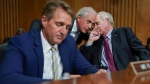 Chairman Sen. Bob Corker, R-Tenn., center, confers with Sen. Ron Johnson, R-Wis., right, as Sen. Jeff Flake, R-Ariz., left, reads nearby during a Senate Foreign Relations Committee hearing on North Korea on Capitol Hill in Washington, Tuesday, Nov. 14, 2017. (AP Photo/Pablo Martinez Monsivais)