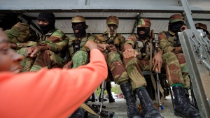 Zimbabwean soldiers bump fists with joyful protesters thanking them near Zimbabwe Grounds in Harare, Zimbabwe Saturday, Nov. 18, 2017.  (AP Photo/Ben Curtis)