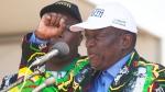 In this Aug. 30 2017 file photo, Zimbabwean Deputy President, Emmerson Mnangagwa, greets party supporters at a ZANU-PF rally in Gweru, Zimbabwe. (AP Photo/Tsvangirayi Mukwazhi, File)