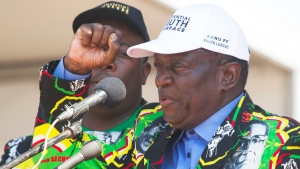In this Aug. 30 2017 file photo, Zimbabwean Deputy President, Emmerson Mnangagwa, greets party supporters at a ZANU-PF rally in Gweru, Zimbabwe. (AP Photo/Tsvangirayi Mukwazhi, File)