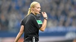 In this Oct. 20, 2017 file photo, female referee Bibiana Steinhaus blows the whistle during the German Bundesliga soccer match between FC Schalke 04 and FSV Mainz 05 at the Arena in Gelsenkirchen, Germany. (AP Photo/Martin Meissner, file)