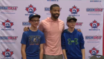 Dalton Pompey of the Toronto Blue Jays poses for a photo with young athletes in Kitchener.