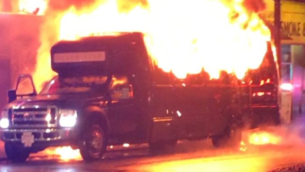 A party bus burns just off the busy Granville Strip in downtown Vancouver on Saturday, Nov. 18, 2017. (Twitter/gdiddy86)