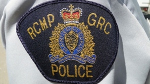 RCMP say a 50-year-old woman is facing charges of assault with a weapon after stabbing a 53-year-old man on Nov. 2.