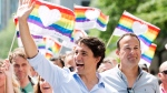Prime Minister Justin Trudeau, left, and Irish Taoiseach Leo Varadkar, right, participate in the annual pride parade in Montreal, Sunday, August 20, 2017. (Graham Hughes/The Canadian Press)