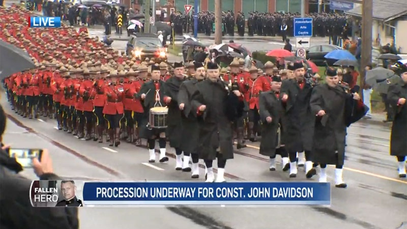 Members of the RCMP march in Const. John Davidson's funeral procession on Nov. 19, 2017.
