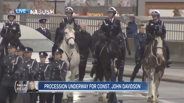 An estimated 6,000-8,000 officers came out to honour Const. John Davidson.