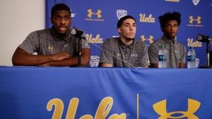 UCLA basketball player Cody Riley, left, reads his statement as he is joined by teammates LiAngelo Ball, center, and Jalen Hill during a news conference at UCLA Wednesday, Nov. 15, 2017, in Los Angeles. (AP Photo/Jae C. Hong)