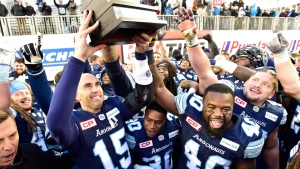Toronto Argonauts quarterback Ricky Ray (15) hoists the trophy with teammates after beating the Saskatchewan Roughriders in the CFL Eastern final, Sunday, November 19, 2017 in Toronto. (Frank Gunn/The Canadian Press)