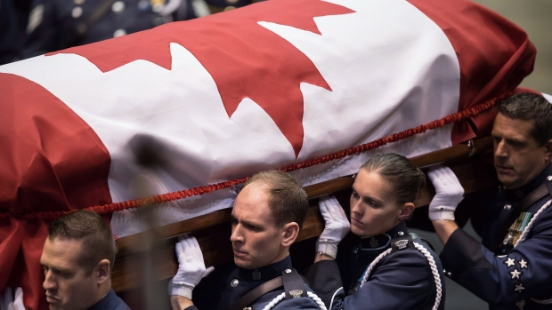 Pallbearers carry the casket of Abbotsford Police Const. John Davidson, who was killed in the line of duty on November 6, into a memorial service in Abbotsford, B.C., on Sunday November 19, 2017. THE CANADIAN PRESS/Darryl Dyck