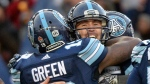 Toronto Argonauts quarterback Ricky Ray, right, celebrates with slotback S.J. Green (19) during second half CFL East Division final football action against the Saskatchewan Roughriders at BMO Field in Toronto, Sunday, Nov.19, 2017. THE CANADIAN PRESS/Nathan Denette