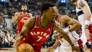 Toronto Raptors guard Kyle Lowry (7) manoeuvres past Washington Wizards guard Tim Frazier (8) in first half NBA basketball action against the Washington Wizards in Toronto on Sunday, November 19, 2017. (Christopher Katsarov/The Canadian Press)