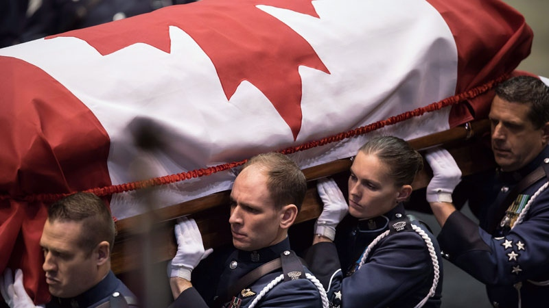 Pallbearers carry the casket of Abbotsford Police Const. John Davidson (THE CANADIAN PRESS/Darryl Dyck)