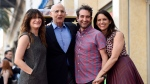 "Jeffrey Tambor, second from left, a cast member in the Amazon series ""Transparent,"" poses with fellow cast members, from left, Kathryn Hahn, Jay Duplass and Amy Landecker during a ceremony awarding him a star on the Hollywood Walk of Fame on Tuesday, Aug. 8, 2017. (Chris Pizzello / Invision)"