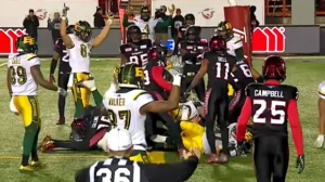 The Eskimos celebrate Mike Reilly's one yard touchdown run in the fourth quarter that reduced the Stamps' lead to 31-25 after the convert