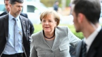 German chancellor and chairwoman of the Christian Democratic party, CDU, Angela Merkel arrives for exploratory talks with the Free Democrats, FDP, and the Greens in Berlin, Germany, Sunday, Nov. 19, 2017. (Soeren Stache/dpa via AP)