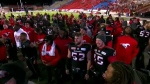 Members of the Calgary Stampeders celebrate following their 32-28 victory over the Eskimos in the 2017 CFL Western Final