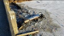 Ken McInnes' truck sits in icy water after plunging off a bridge. (CTV Winnipeg)