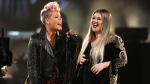 "Pink, left, and Kelly Clarkson perform ""Everybody Hurts"" at the American Music Awards at the Microsoft Theater on Sunday, Nov. 19, 2017, in Los Angeles. (Matt Sayles/Invision/AP)"