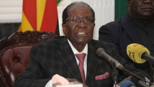 Zimbabwean President Robert Mugabe delivers his speech during a live broadcast at State House in Harare, Sunday, Nov, 19, 2017. Zimbabwe's President Robert Mugabe has baffled the country by ending his address on national television without announcing his resignation. (AP Photo)