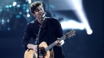"Shawn Mendes performs ""There's Nothing Holdin' Me Back"" at the American Music Awards at the Microsoft Theater on Sunday, Nov. 19, 2017, in Los Angeles. (Photo by Matt Sayles/Invision/AP)"