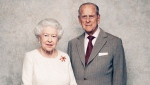 In this handout photo issued by Camera Press and taken in Nov. 2017, Queen Elizabeth and Prince Philip pose for a photograph in the White Drawing Room pictured against a platinum-textured backdrop at Windsor Castle, England. Queen Elizabeth II and Prince Philip are marking 70 years since they wed in London's Westminster Abbey. At the time, Princess Elizabeth was just 21 and Philip, a naval officer, was 26. Their wedding was a spark of joy and celebration in a country just recovering from World War II. (Matt Holyoak/Camera Press via AP)