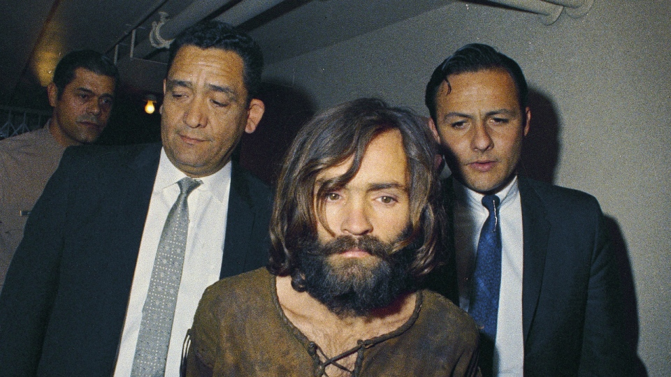 Charles Manson is escorted to his arraignment on conspiracy-murder charges in connection with the Sharon Tate murder case in 1969. (AP)