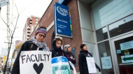 Teachers and faculty staff of the Ontario Public Service Employees Union walk the picket line at George Brown College in Toronto on Thursday, November 16, 2017. Ontario's striking college facility voted to reject a contract offer and continue their nearly five-week job action. The 12,000 college professors, instructors, counsellors, and librarians have been off the job since Oct. 15, leaving some 500,000 students out of class. THE CANADIAN PRESS/Nathan Denette