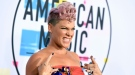 Pink arrives at the American Music Awards at the Microsoft Theater on Sunday, Nov. 19, 2017, in Los Angeles. (Jordan Strauss/Invision/AP)