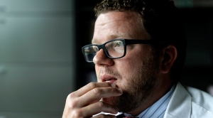 Dr. Dan Lonergan, a pain specialist who also focuses on addiction, sits in his office in Franklin, Tenn., Monday, June 5, 2017. Lonergan faced his own dark abyss years ago when his older brother died suddenly of a possible opioid overdose. (AP /David Goldman)