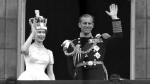 Queen Elizabeth II and Prince Philip, Duke of Edinburgh, as they wave to supporters from the balcony at Buckingham Palace, following her coronation at Westminster Abbey. London, June. 2, 1953. (AP Photo/Leslie Priest)