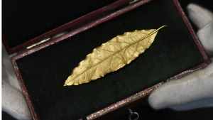 A gold laurel leaf removed from the crown Napoleon Bonaparte wore to his coronation.(AFP / Stephane De Sakutin)