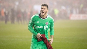 Toronto FC Alex Bono celebrates after the final whistle after defeating the New York Red Bulls on away goals to win the MLS Eastern Conference semifinal in Toronto on Sunday, November 5, 2017. (THE CANADIAN PRESS/Chris Young)