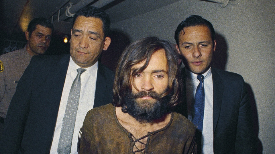 In this 1969 file photo, Charles Manson is escorted to his arraignment on conspiracy-murder charges in connection with the Sharon Tate murder case. (AP Photo, File)