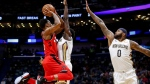 Toronto Raptors guard DeMar DeRozan (10) shoots over New Orleans Pelicans guard Jrue Holiday (11) and center DeMarcus Cousins (0) in the first half of an NBA basketball game in New Orleans, Wednesday, Nov. 15, 2017. (AP / Scott Threlkeld)