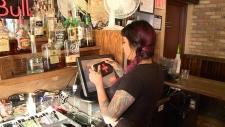 Roxy Khan at Pub 101 with Naloxone kit.