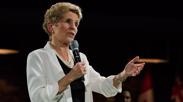 Premier Kathleen Wynne addresses questions from the public during a town hall meeting in Toronto on Monday, November 20, 2017. THE CANADIAN PRESS/Christopher Katsarov