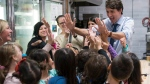 FILE -- Prime Minister Justin Trudeau meets with school children at Laura's Coffee Corner in White Rock, B.C., on Wednesday, Nov. 15, 2017. THE CANADIAN PRESS/Richard Lam