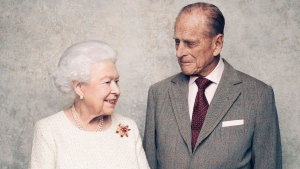 In this handout photo issued by Camera Press and taken in Nov. 2017, Britain's Queen Elizabeth and Prince Philip pose for a photograph in the White Drawing Room pictured against a platinum-textured backdrop at Windsor Castle, England. Britain's Queen Elizabeth II and Prince Philip are marking 70 years since they wed in London's Westminster Abbey. At the time, Princess Elizabeth was just 21 and Philip, a naval officer, was 26. Their wedding was a spark of joy and celebration in a country just recovering from World War II. (Matt Holyoak/Camera Press via AP)