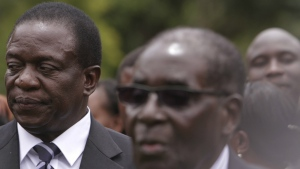 Emmerson Mnangagwa, left, Vice President of Zimbabwe stands behind Zimbabwean President Robert Mugabe after his swearing in ceremony at State House in Harare on Dec. 2014. (AP / Tsvangirayi Mukwazhi)