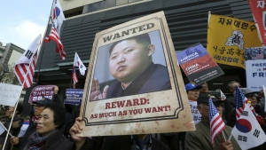 An anti-North Korea protester holds up a portrait of North Korean leader Kim Jong Un during a rally welcoming the visit by U.S. President Donald Trump near the U.S. Embassy in Seoul, South Korea on Monday, Nov. 6, 2017. (AP / Ahn Young-joon)