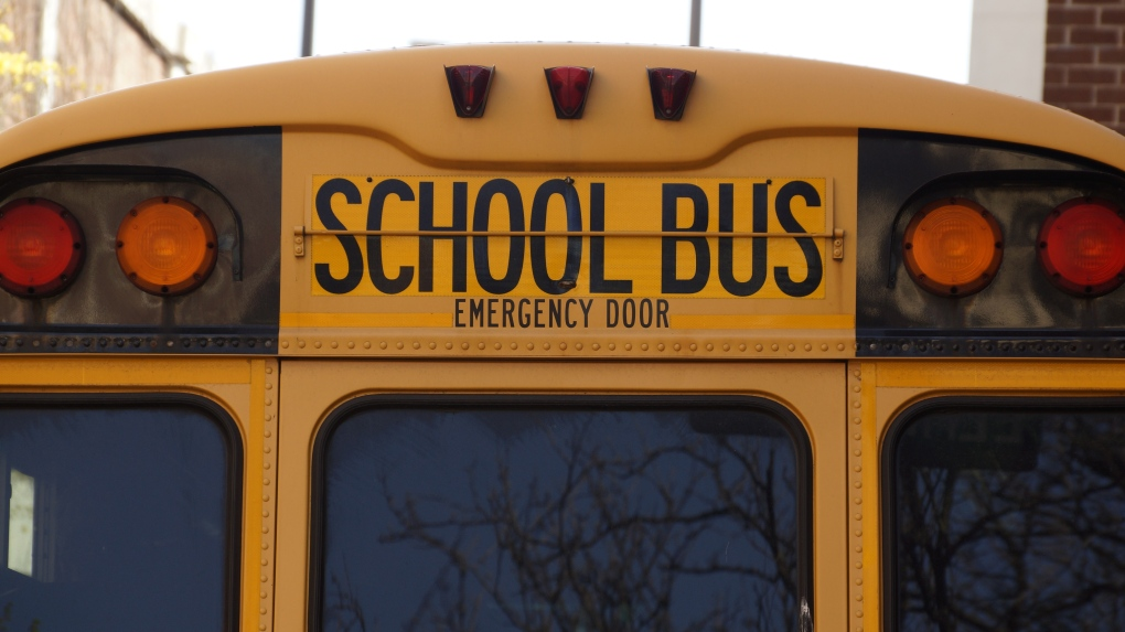 School bus driver charged after collision