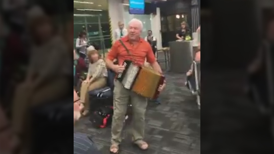 A man plays the accordion at Toronto's Pearson International Airport on Nov. 20, 2017. (Michelle Sacrey Philpott / Facebook)