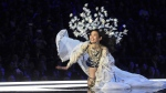 Chinese model Ming Xi falls as she presents a creation during the 2017 Victoria's Secret Fashion Show in Shanghai. (FRED DUFOUR / AFP)