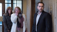 Christopher Calvin Garnier, right, charged with second-degree murder in the death of Truro police officer Const. Catherine Campbell, arrives at Nova Supreme Court with family members in Halifax on Tuesday, Nov. 21, 2017. (The Canadian Press/Andrew Vaughan)