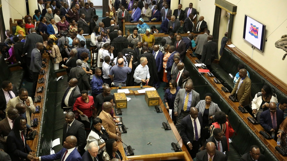 Members of the House of Assembly sit inside the Zimbabwean Parliament in Harare, Zimbabwe, Tuesday, Nov. 21 2017.  (AP Photo/Aaron Ufumeli)