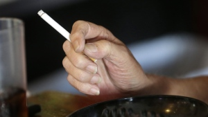 In this April 21, 2015, file photo, a patron smokes a cigarette inside a bar in New Orleans hours before a smoking ban takes effect in bars, gambling halls and many other public places such as hotels, workplaces, private clubs and stores. (AP Photo/Gerald Herbert, File)